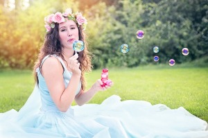 pretty woman blowing bubbles